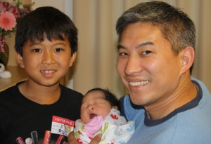Jim Lin with his son and new daughter