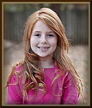 cute little red headed girl with a lost tooth