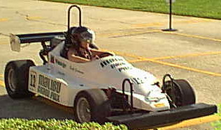 The Peachy1 in a mini race car smoking the competition
