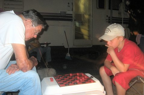 Alex and his pawpaw playing checkers on our camping trip