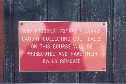 balls removed, golf course sign