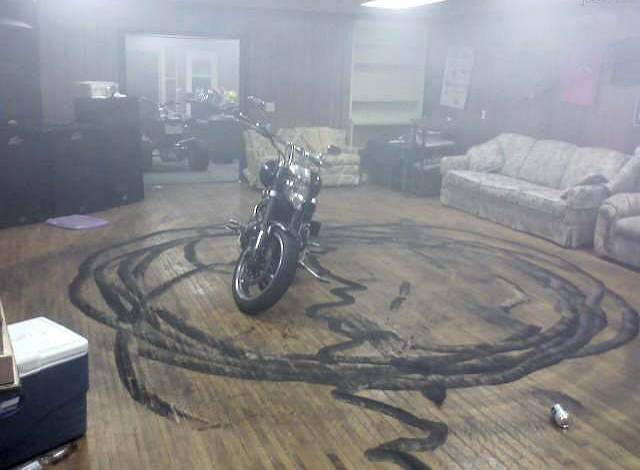 unsupervised men motorcycle doughnuts on the living room floor