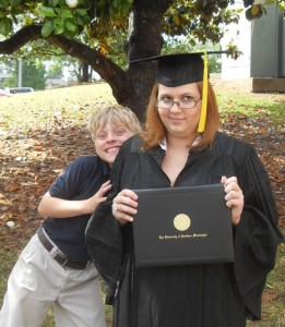 A picture of the graduate, and her little brother on Being Peachy epic asshattedness