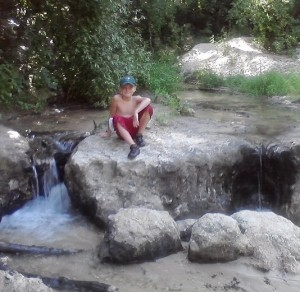 Prince Alex sitting at the falls